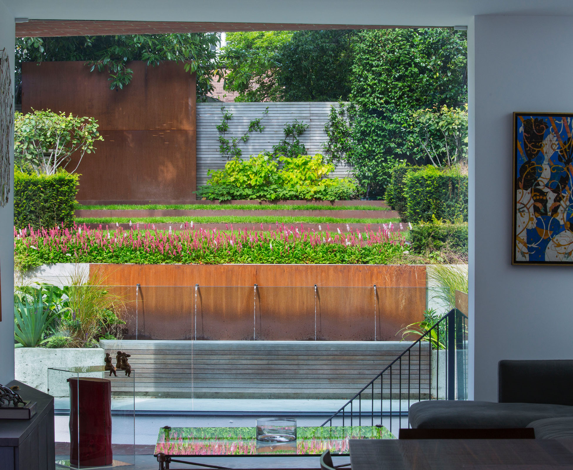 The dramatic window out from the kitchen offers a theatrical view onto the garden.