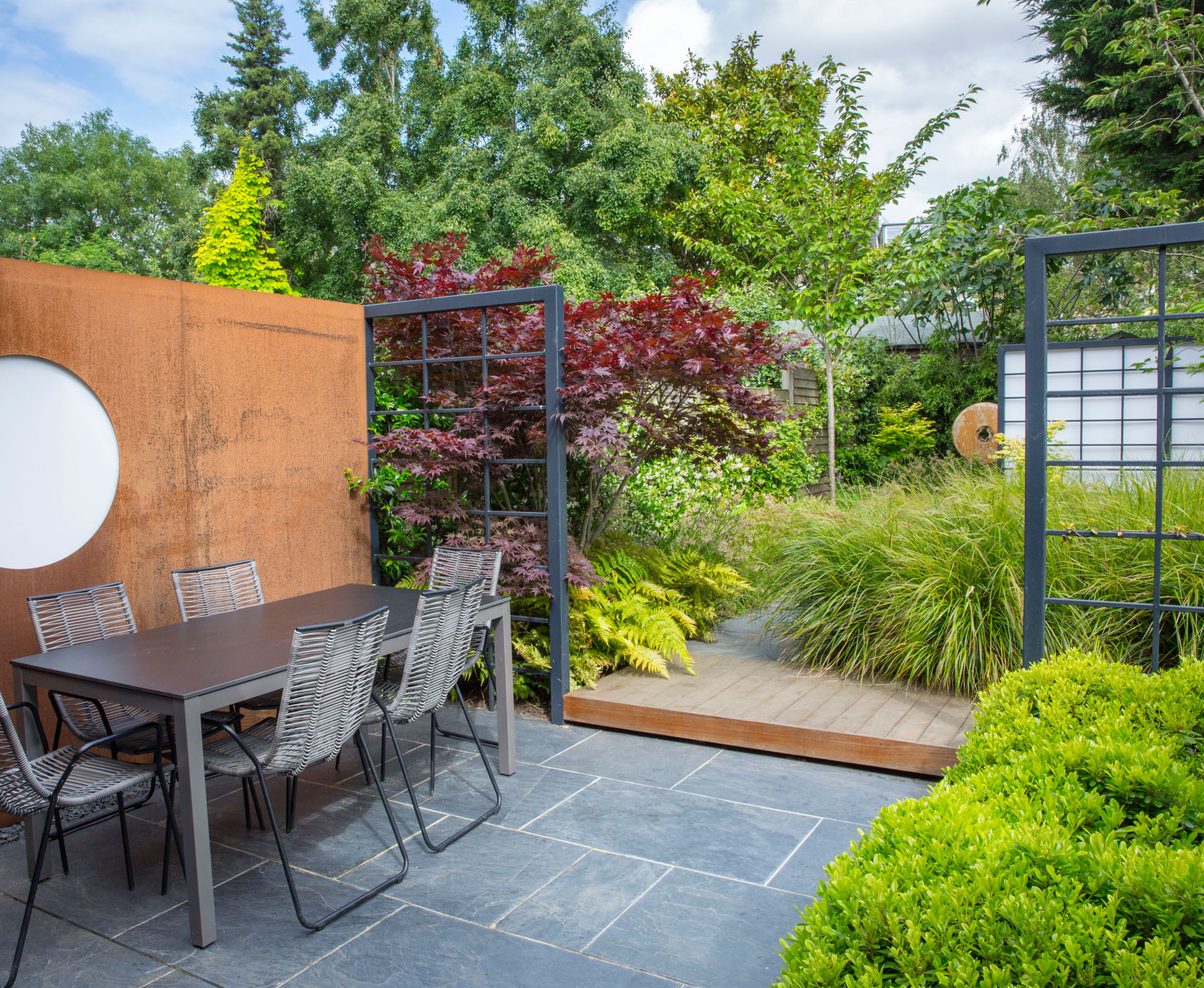 A Corten Steel Moon window becomes a feature of this garden.