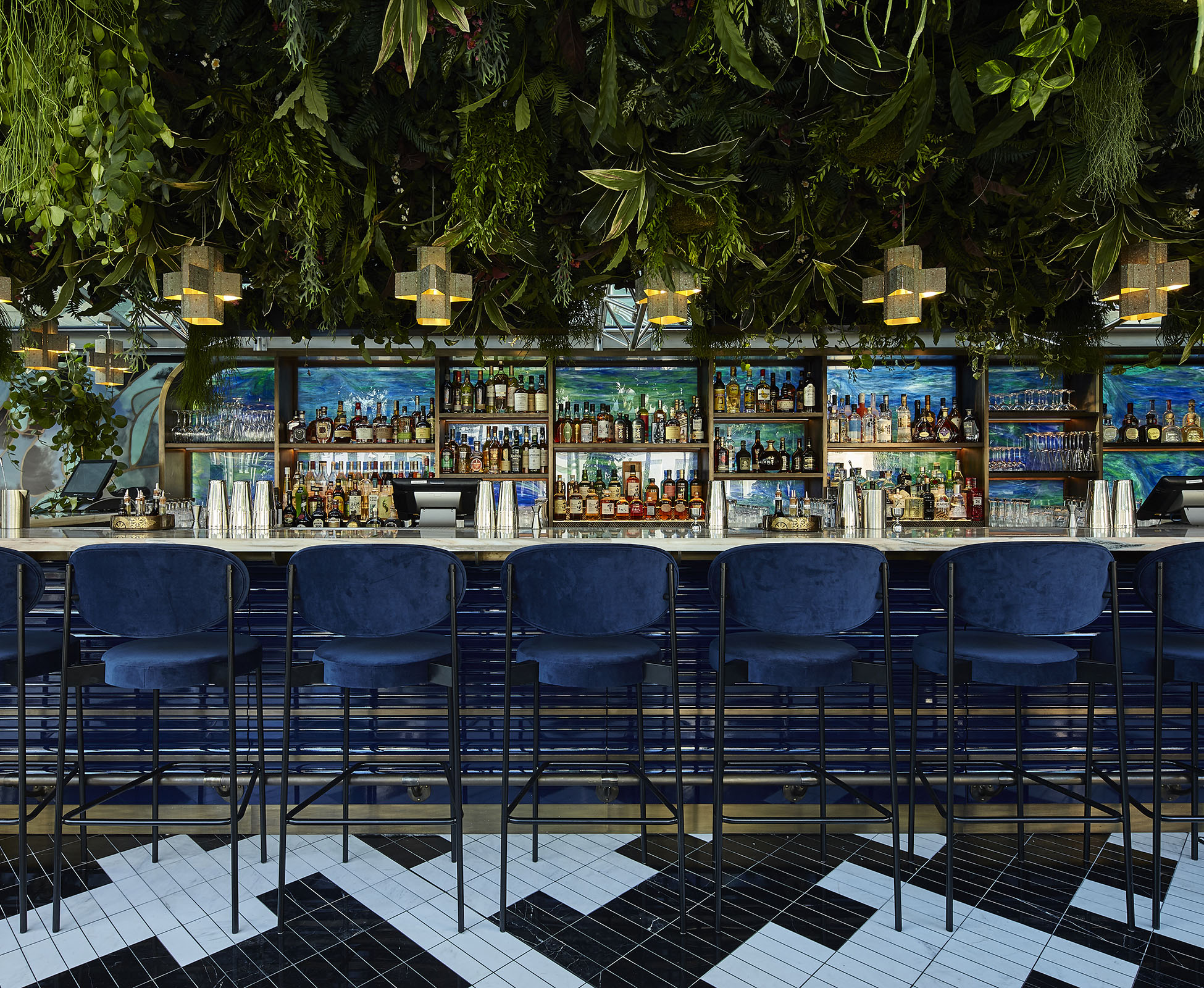 A suspended living ceiling of plants hovers above the cocktail bar at Sushisamba Covent Garden. It is created using a diverse range of plants from Asia and South America to reflect the restaurant's origins.