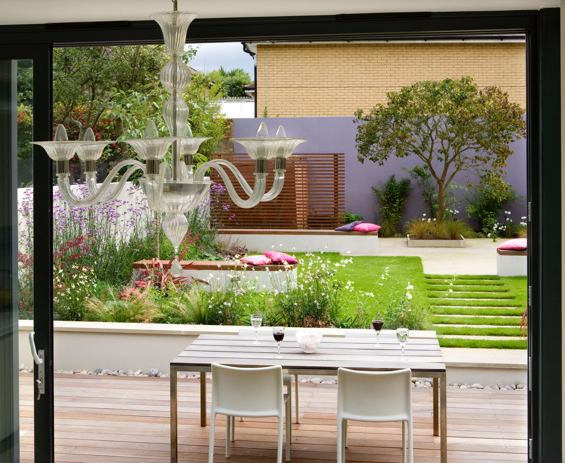The view out onto this contemporary garden, shows the clean, lines of the geometric design.